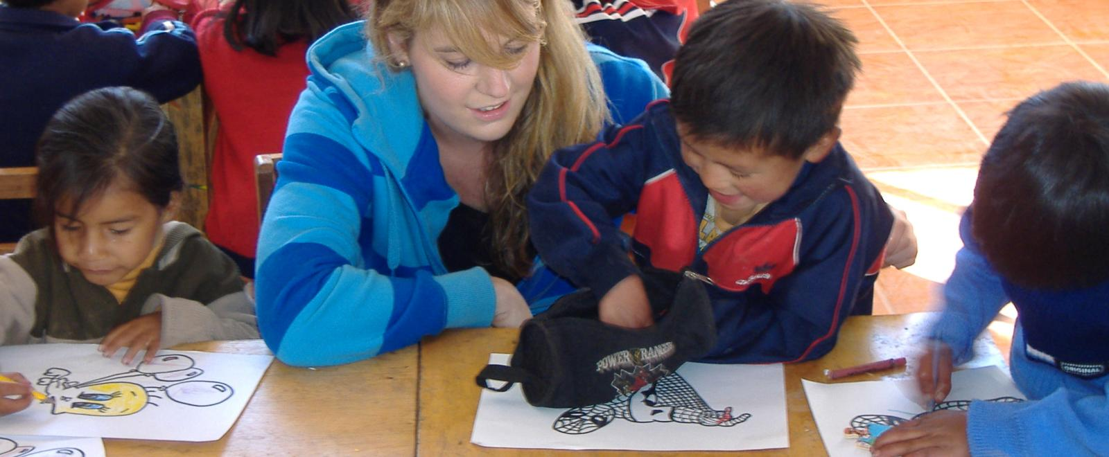 Projects Abroad volunteer works with children on Childhood Development project in Peru